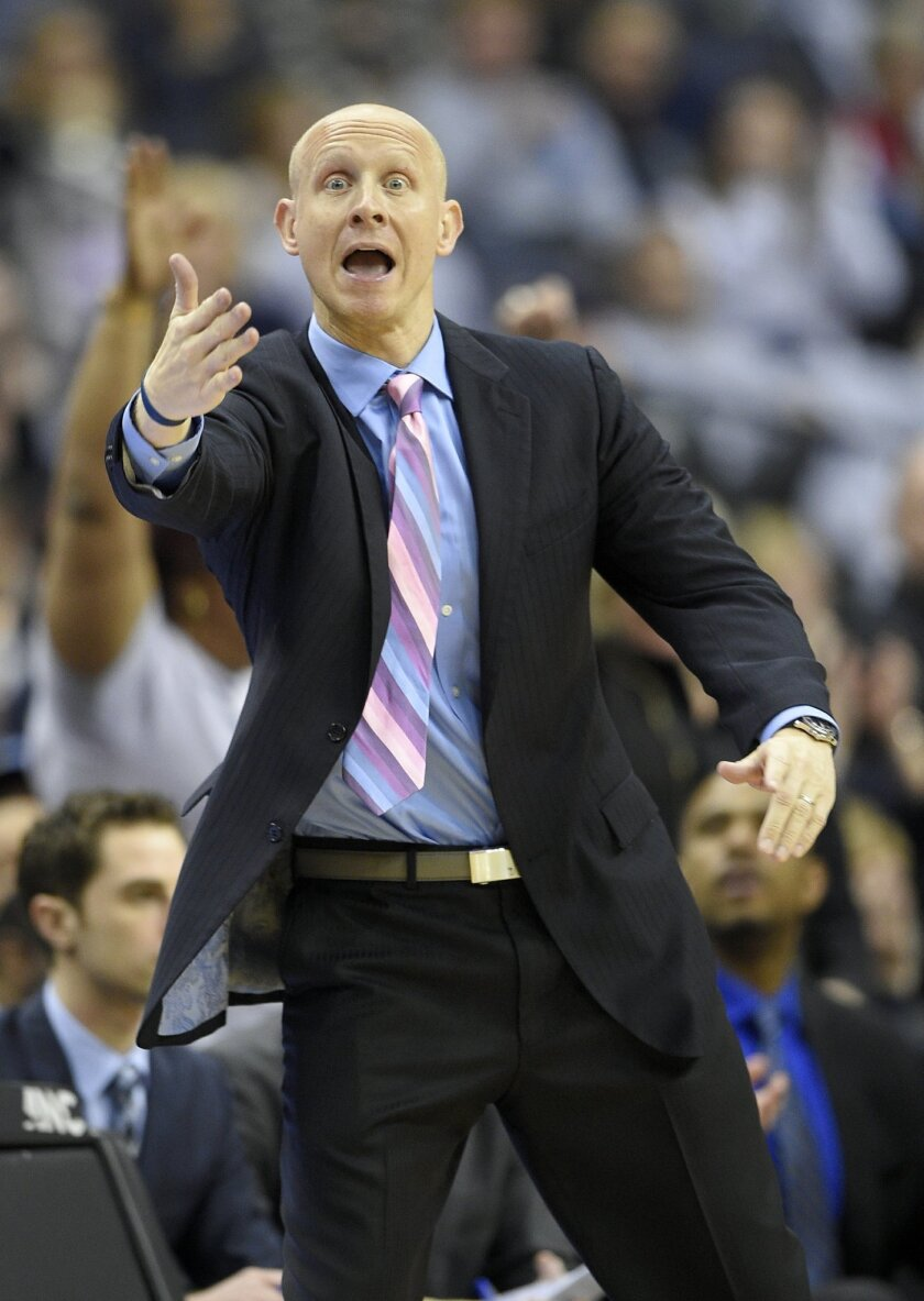 Xavier head coach Chris Mack gestures during the second half of an NCAA college basketball game against Georgetown, Saturday, Feb. 20, 2016, in Washington. Xavier won 88-70. (AP Photo/Nick Wass)