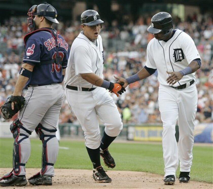 Detroit Tigers' Miguel Cabrera, center, is congratulated by Marcus Thames, right, after hitting a two-run home run in the third inning in a baseball game Tuesday, July 8, 2008, in Detroit. At left is Cleveland Indians catcher Kelly Shoppach. (AP Photo/Duane Burleson)
