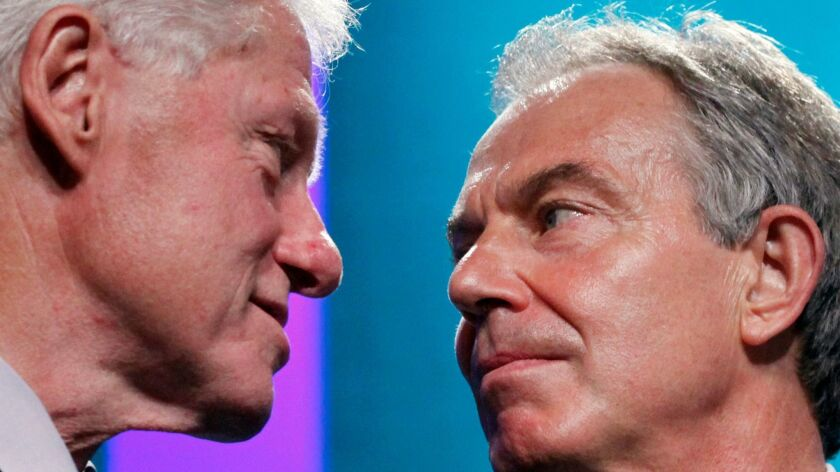 Former U.S. President Bill Clinton, left, and former Prime Minister of the United Kingdom Tony Blair