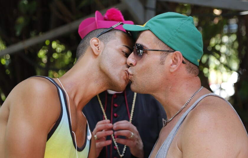 A gay Cuban couple kissing