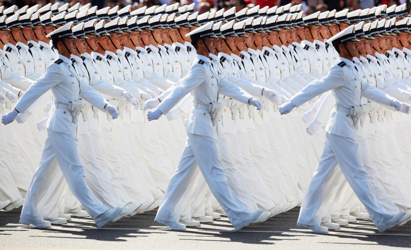 In a 2009 file photo, Chinese People's Liberation Army sailors march pass Tiananmen Square during the celebration of the 60th anniversary of the founding of the People's Republic of China.