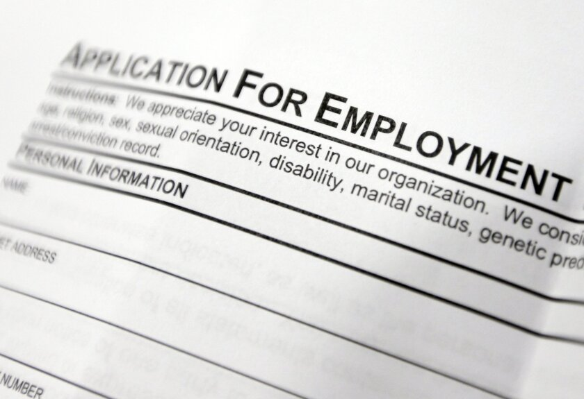 FILE - This April 22, 2014, file photo shows an employment application form on a table during a job fair at Columbia-Greene Community College in Hudson, N.Y. The Labor Department reports on job openings and labor turnover in June 2014 on Tuesday, Aug. 12, 2014. (AP Photo/Mike Groll, File)