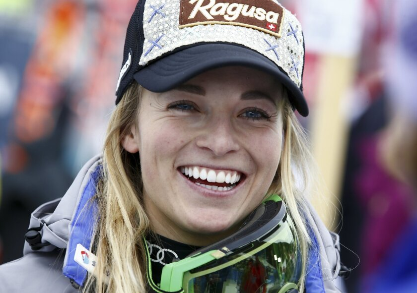 Switzerland's Lara Gut smiles after completing an Alpine Ski women's World Cup Super G race, in Garmisch Partenkirchen, Germany, Sunday, Feb. 7, 2016. (AP Photo/Gio Auletta)