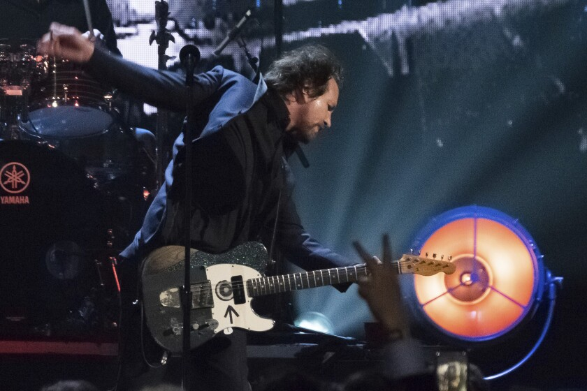FILE - In this Friday, April 7, 2017, file photo, inductee Eddie Vedder from the band Pearl Jam performs at the 2017 Rock and Roll Hall of Fame induction ceremony at the Barclays Center in New York. Pearl Jam is postponing multiple U.S. and Canadian shows on their Gigaton tour because of coronavirus concerns. (Photo by Charles Sykes/Invision/AP, File)