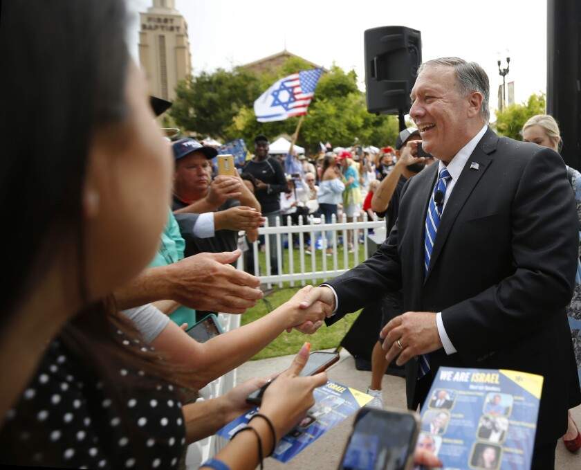 """Mike Pompeo greets people at """"We Are Israel"""", a rally against antisemitism in El Cajon on Sunday, July 25, 2021."""