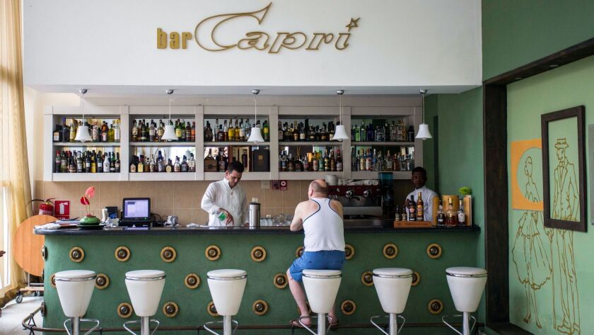 FILE - In this Sept. 12, 2017, file photo, a customer sits at the lobby bar of the Hotel Capri in Ha