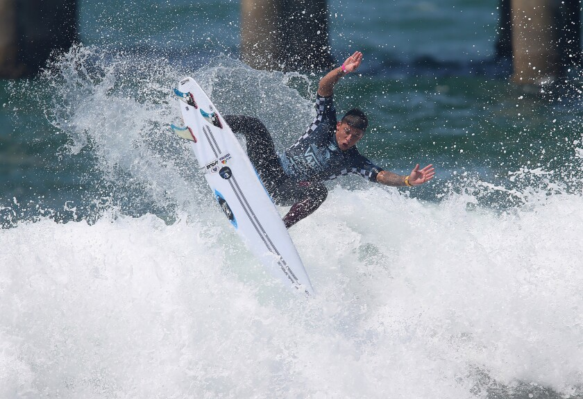 Brazil's Peterson Crisanto goes high in the air off the foam in route to highest heat score as he competes in round 2 of the Men's QS10000 during the Van's US Open of Surfing on Tuesday.