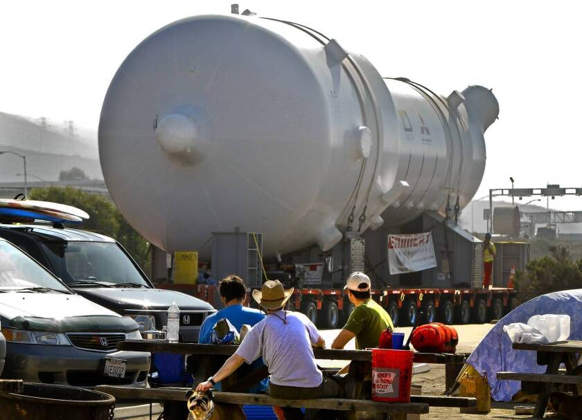 Campers at San Onofre State Beach watch as a replacement steam generator is hauled toward the San Onofre nuclear plant in 2010. Sen. Barbara Boxer and Rep. Edward Markey said in a letter that problems with such generators were known before they were installed.