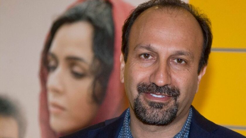 """FILE - In this Oct. 10, 2016 file photo, Iranian director Asghar Farhadi poses for a photo during the premiere of his film, """"The Salesman, in Paris. Iranian director Farhadi, whose feature film """"The Salesman"""" is nominated for a best foreign language Oscar."""