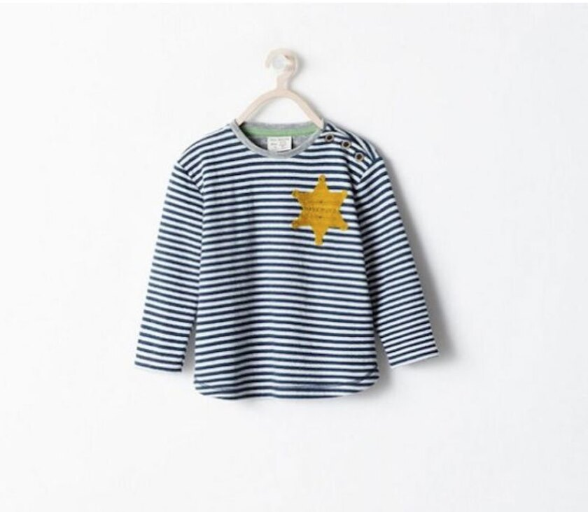 A shirt pulled from Zara store shelves because of its strong resemblance to the uniforms worn by Jews imprisoned in Nazi concentration camps.