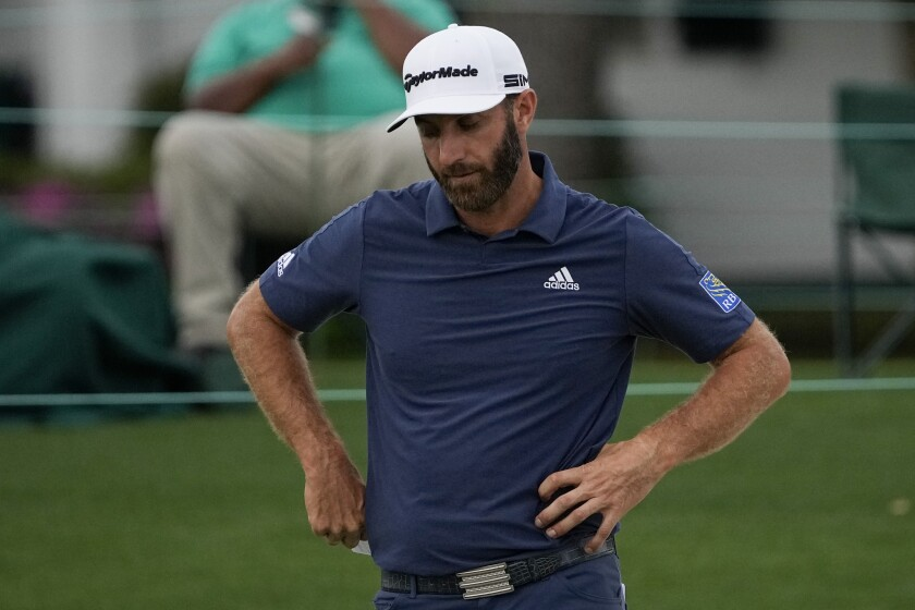 Dustin Johnson looks down after putting on the 18th hole during the second round of the Masters golf tournament on Friday, April 9, 2021, in Augusta, Ga. (AP Photo/Gregory Bull)