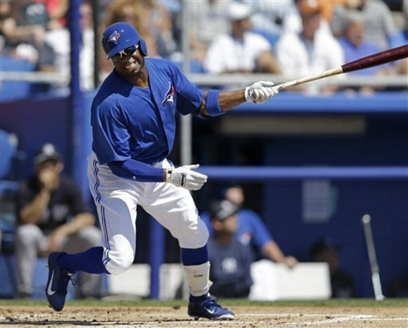 Toronto Blue Jays left fielder Rajai Davis (11) reacts during a first-inning at-bat in the Jays 3-0 shutout loss to the New York Yankees in a spring training baseball game at Steinbrenner Field in Dunedin, Fla., Sunday, March 10, 2013. (AP Photo/Kathy Willens)