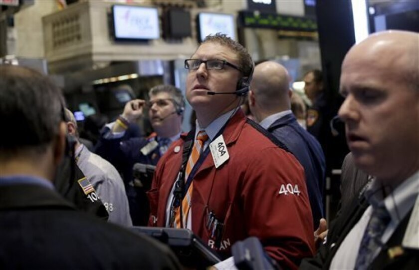 FILE - In this Tuesday, Sept. 3, 2013, file photo, traders work on the floor at the New York Stock Exchange in New York. Stock futures are rising and the price of oil is falling, Tuesday, Sept. 10, 2013, with a U.S. attack on Syria no longer appearing imminent. (AP Photo/Seth Wenig)