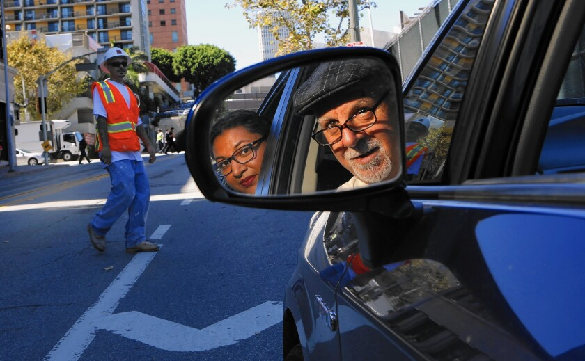 Steve Lopez, moonlighting as an Uber driver, with his first customer, Eloisa Lopez.