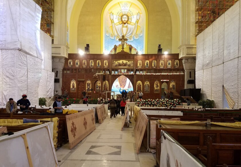 Workers prepare for Christmas Eve Mass to be held Friday night at St. Mark's Coptic Orthodox Cathedral in Cairo.