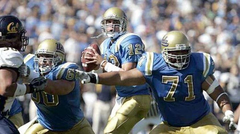 UCLA linemen Chris Joseph, left, and Shannon Tevaga provide protection for quarterback Patrick Cowan. Their ability to contain a USC defense that averages 3.3 sacks per game could be a key to the Bruins' chances on Saturday.