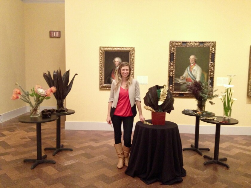 Katherine Brozowski stands among various floral creations during Art Alive at the San Diego Museum of Art.