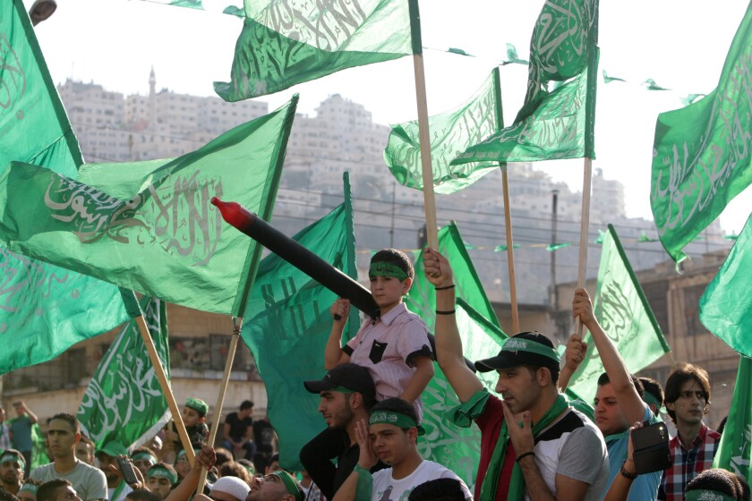 Palestinians hold Hamas flags during a celebration organized by Hamas in the West Bank city of Nablus on Aug. 29.