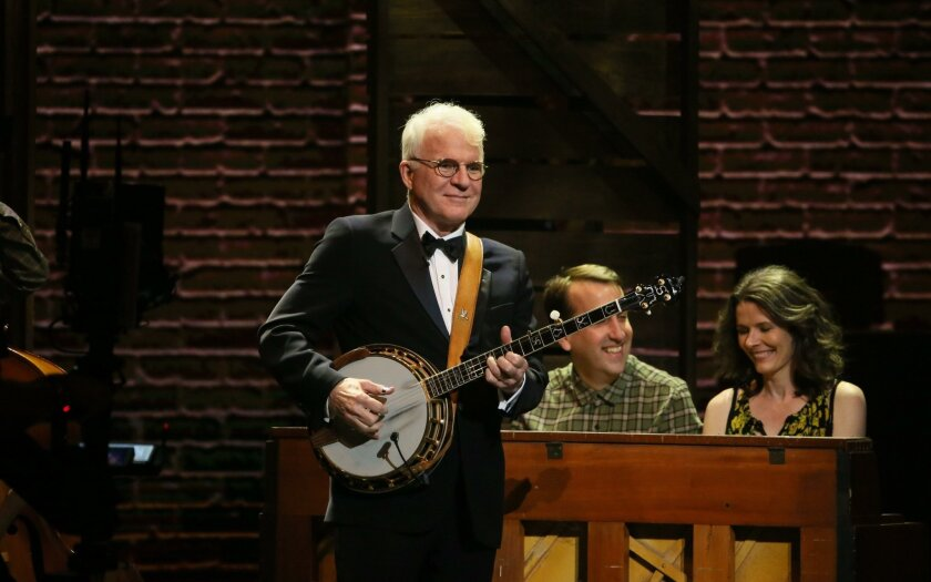 """Steve Martin plays banjo as the cast of the Old Globe-bred musical """"Bright Star"""" performs at the 70th Annual Tony Awards in New York. As his play """"Meteor Shower"""" premieres at the Globe , Martin will sit down for an onstage conversation with the theater's artistic director, Barry Edelstein."""