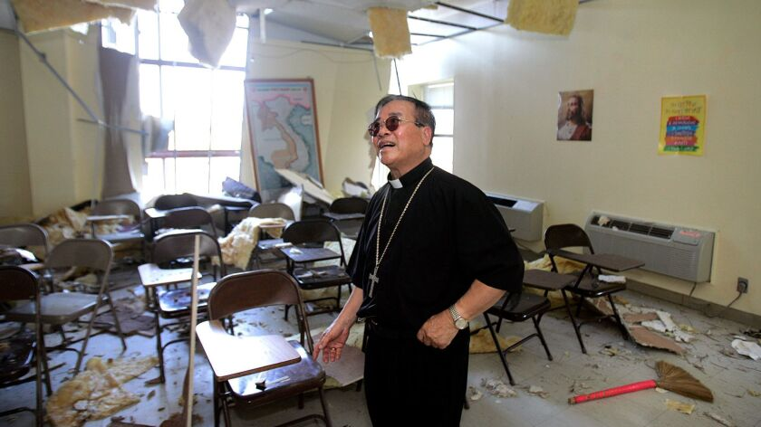 Bishop Dominic Loung returns to Mary Queen of Vietnam Church in New Orleans after it was damaged during Hurricane Katrina.