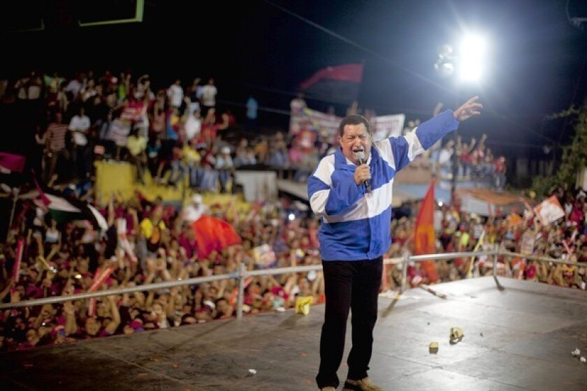 Venezuelan President Hugo Chavez addresses a campaign rally in Valencia. He is running against opposition candidate Henrique Capriles in Sunday's election.