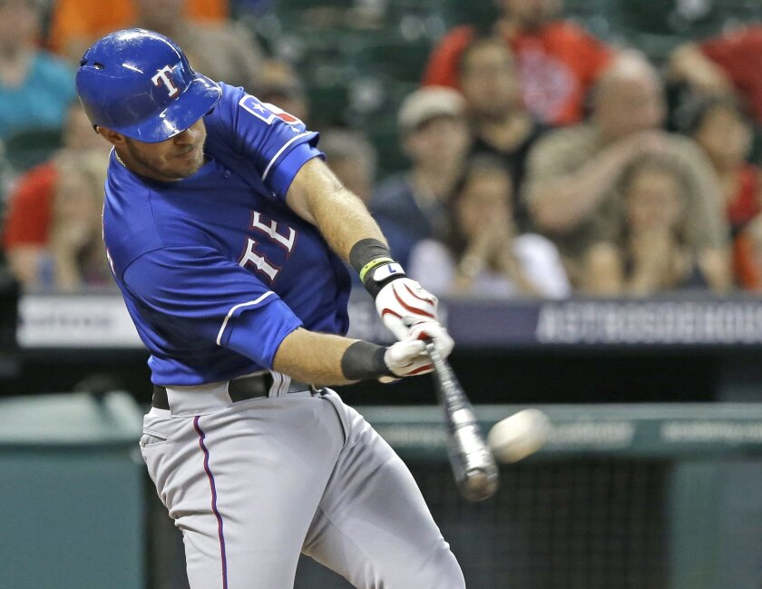 Texas Rangers' J.P. Arencibia connects for a two-run homer against the Houston Astros in the first inning of a baseball game Friday, Aug. 8, 2014, in Houston. (AP Photo/Pat Sullivan)