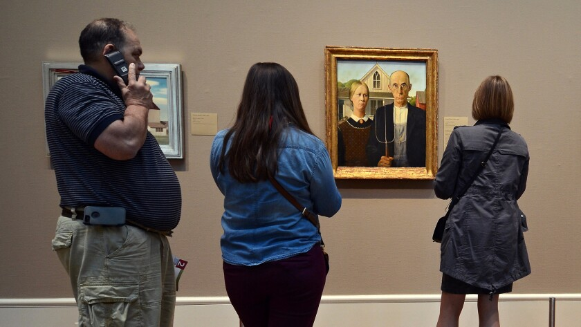 "The original ""American Gothic"" isn't in Iowa, where Grant Wood was born. It's in Chicago at the Chicago Art Institute, where visitors stop to contemplate."