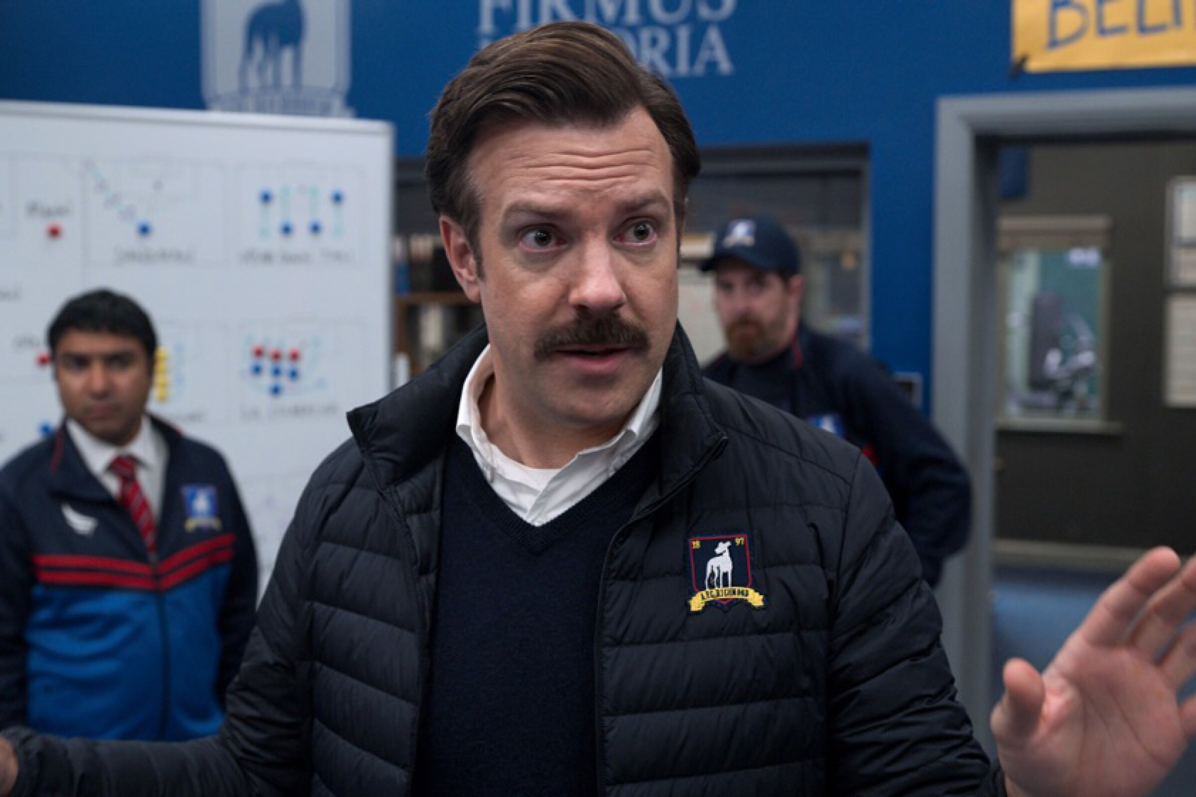 """Jason Sudeikis in """"Ted Lasso,"""" a feel-good sports comedy we recommend for lowering your election day blood pressure."""