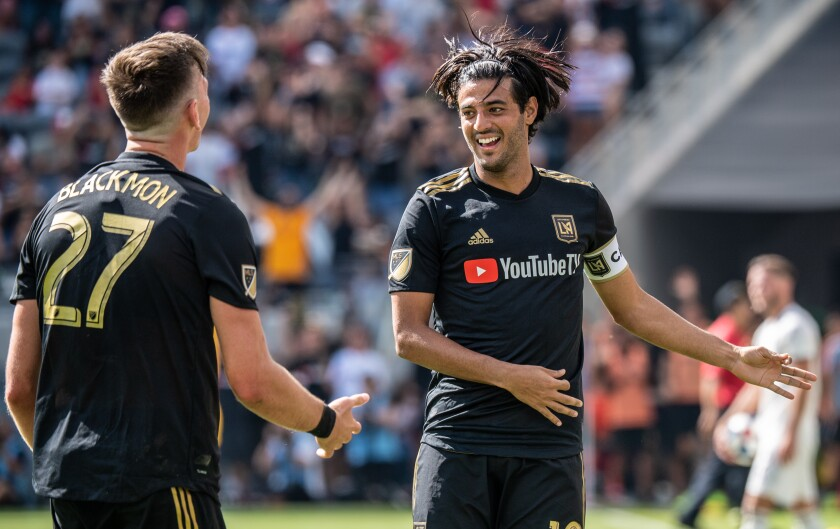 LAFC star Carlos Vela celebrates with teammate Tristan Blackmon after scoring against Sporting Kansas City on Oct. 6.