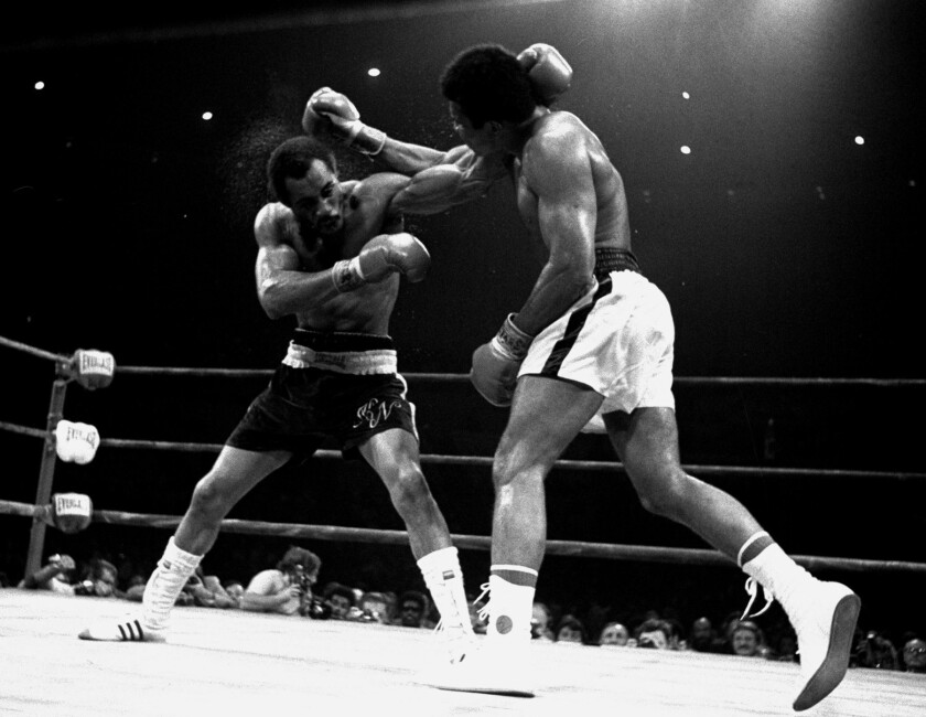Ken Norton Sr., left, trades punches with Muhammad Ali during their 1973 rematch at the Forum in Inglewood. Ali won the fight by split decision.