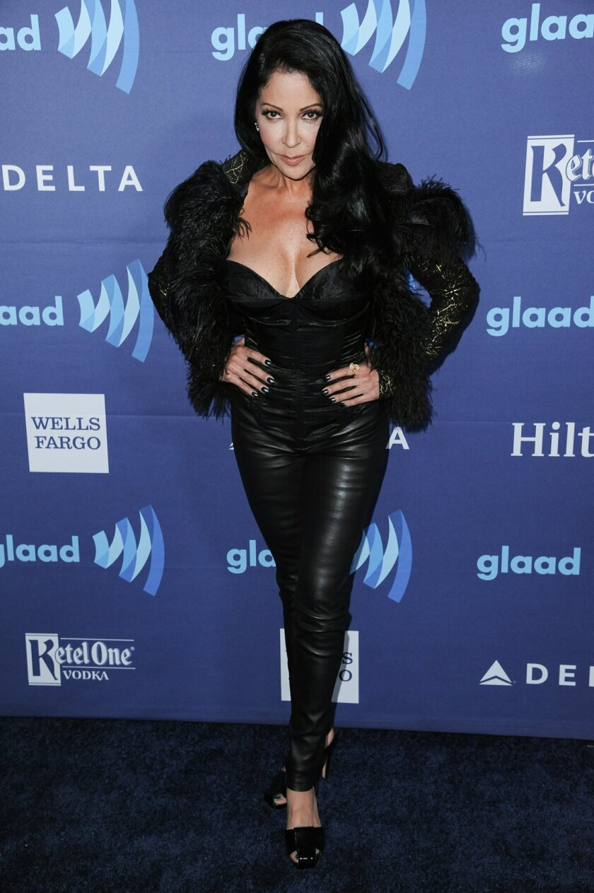 """FILE - In this March 21, 2015 file photo, Apollonia Kotero arrives at the 26th Annual GLAAD Media Awards held at the Beverly Hilton Hotel in Beverly Hills, Calif. The woman who replaced Vanity in Prince's classic movie """"Purple Rain"""" called the now-deceased Denise Matthews an inspiration and one of"""