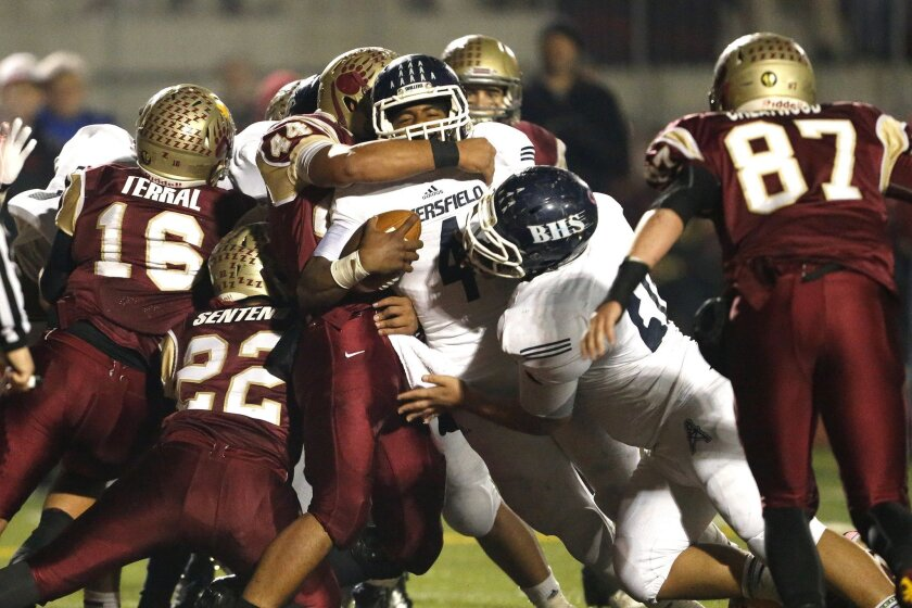 With less than a minute to play, Bakersfield quarterback Asauni Rufus scores the winning touchdown against Mission Hills in Friday's Southern California Regional game.