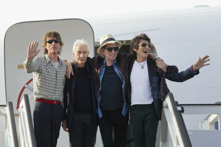 The Rolling Stones, from left, Mick Jagger, Charlie Watts, Keith Richards and Ron Wood pose in 2016 by their plane in Havana.