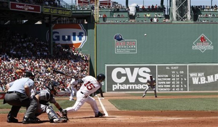 Boston Red Sox's Dustin Pedroia hits a two-run double against the San Diego Padres during the first inning of a baseball game at Fenway Park in Boston Thursday, July 4, 2013. (AP Photo/Winslow Townson)