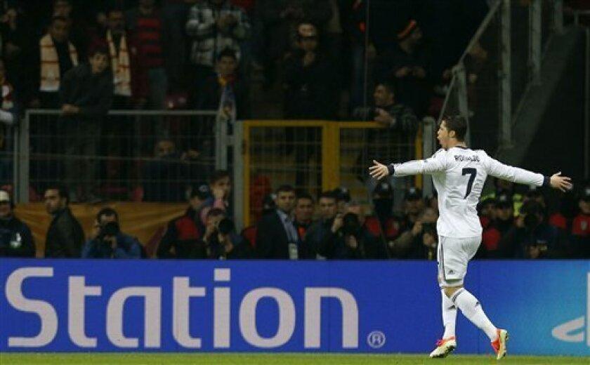 Real Madrid's Ronaldo, celebrates after scoring against Galata Saray during a Champions League quarterfinal soccer match at Ali Sami Yen Spor Kompleksi in Istanbul, Turkey, Tuesday, April 9, 2013. (AP Photo/Thanassis Stavrakis)