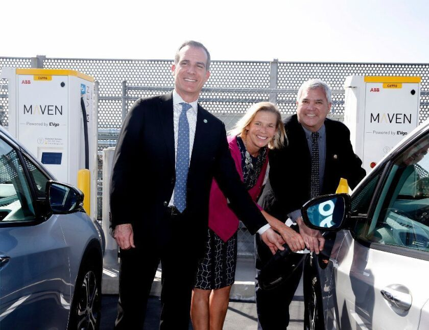 Los Angeles Mayor Eric Garcetti, EVgo Chief Executive Cathy Zoi and Culver City Mayor Thomas Small demonstrate how a Maven electric vehicle charging station works during the unveiling of EvGo network charging stations in Los Angeles on April 22.