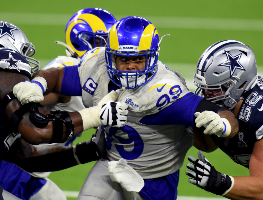 Defensive tackle Aaron Donald tries to break through the Dallas Cowboys' offensive line.
