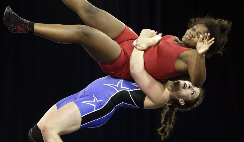 Adeline Gray, bottom, takes down Puerto Rico's Ana Gonzalez during the Pan Am Games on July 17, 2015.