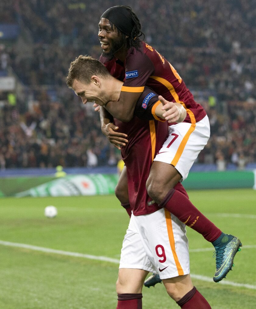 Roma's Edin Dzeko, left, celebrates with teammate Gervinho after scoring during the Champions League group E soccer match between Roma and Bayer Leverkusen at the Olympic stadium, in Rome, Italy, Wednesday, Nov. 4, 2015. (AP Photo/Andrew Medichini)