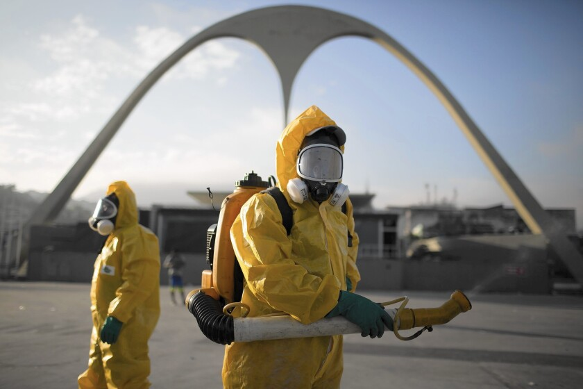 Health workers spray insecticide at Rio de Janeiro's Sambadrome to kill mosquitoes that carry the Zika virus.