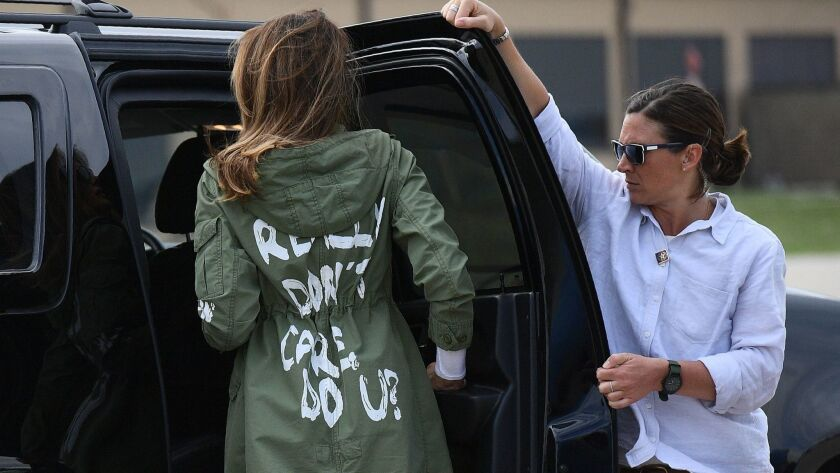 """First Lady Melania Trump in a jacket bearing the words, """"I really don't care. Do u?"""""""