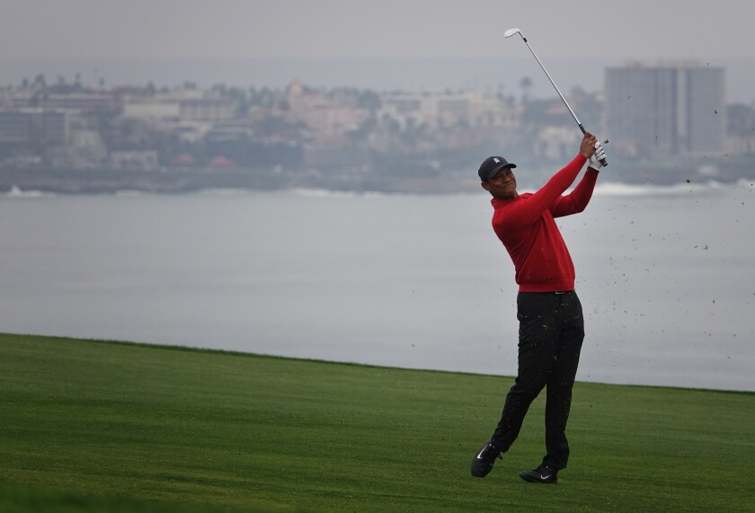 Tiger Woods hits on the fourth hole at Torrey Pines South during the final round of last year's Farmers Insurance Open.