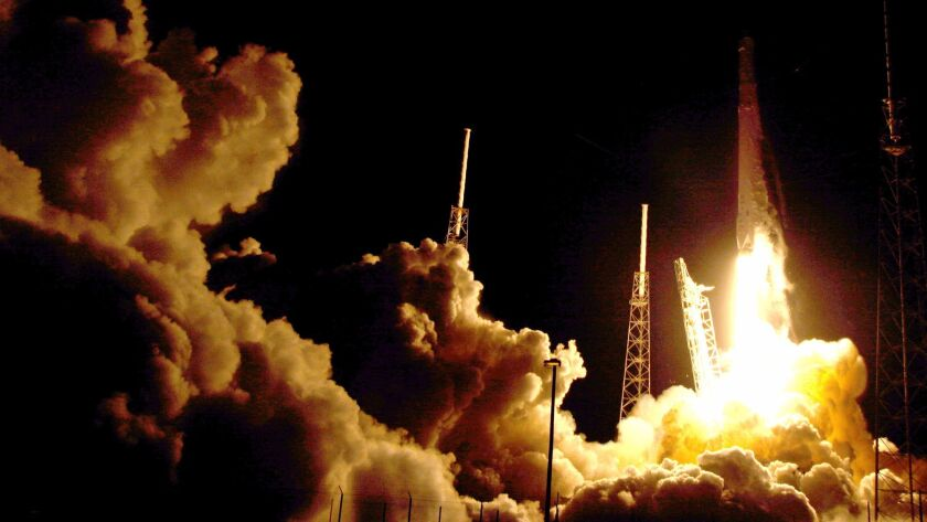 A Falcon 9 SpaceX rocket lifts off at the Cape Canaveral Air Force Station in Florida last year.
