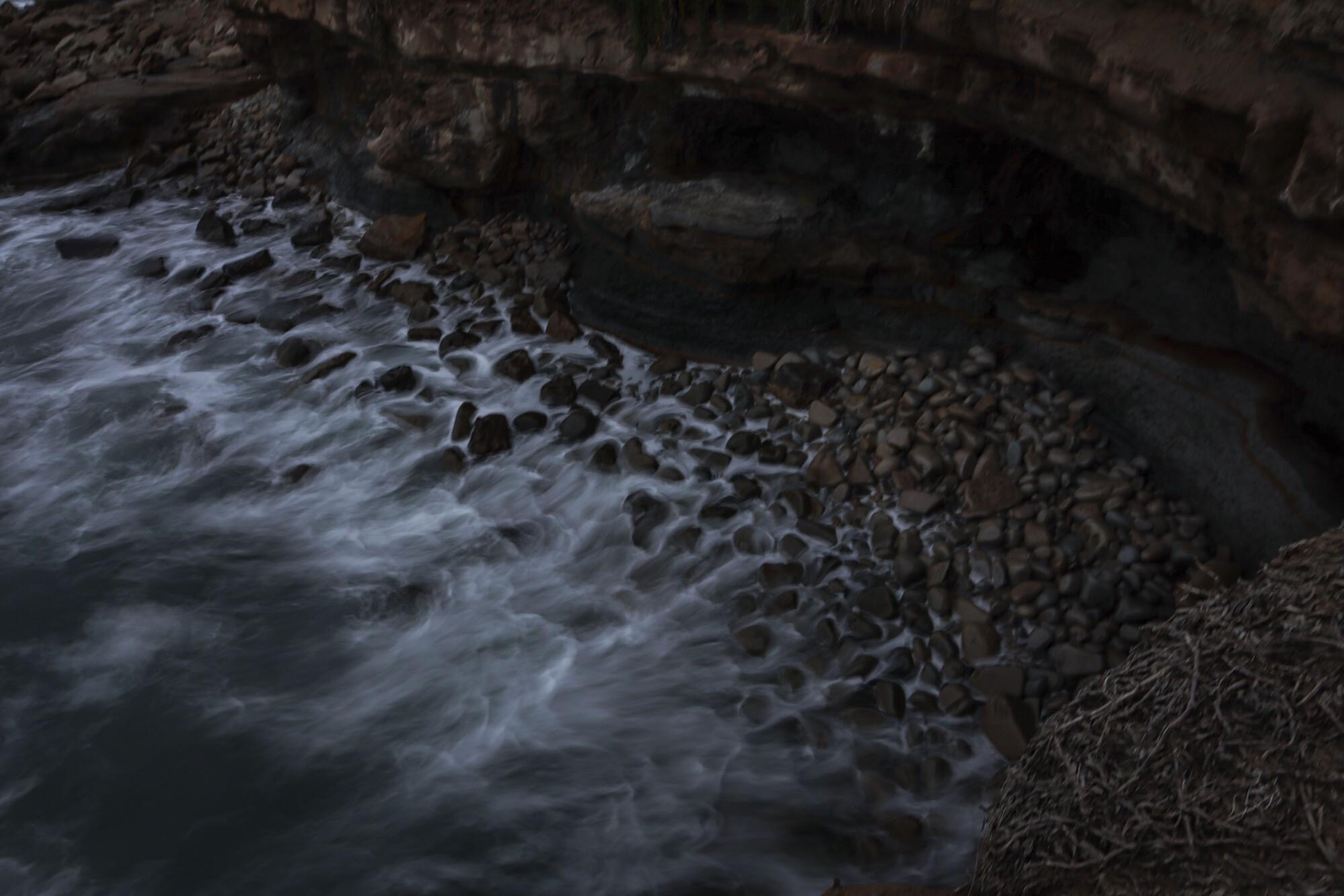 Waves break on a rocky coast.