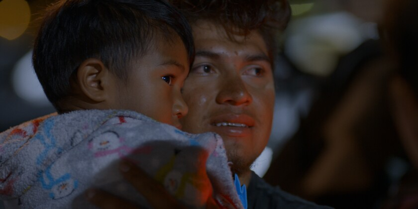 """Luis Diaz holds his toddler son Noah in the docuseries """"Living Undocumented."""""""