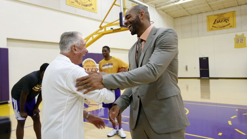 EL SEGUNDO, CA-JULY 25, 2014: Bill Bertka, left, basketball consultant for the Los Angeles Lakers,