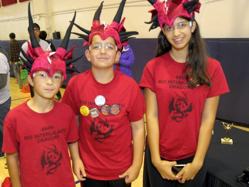 "David Scuba, Malcolm McDonough, and Ella Sobhani from the ""RSF Intergalactic Dragons"""