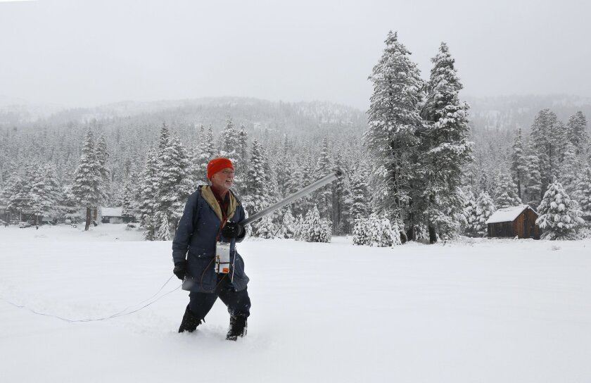 Frank Gehrke, chief of the California Cooperative Snow Survey Program for the Department of Water Resources, walks through a snow covered meadow to conduct the second snow survey of the year near Echo Summit, Calif., Thursday, Jan. 30, 2014. Despite the overnight snow storm the survey showed the snow depth at 12.4 inches with a water content of only 1.4 inches for this location at this time of the year. Gehrke said that while the recent snow fall will help, it is not enough to impact the water supply.(AP Photo)