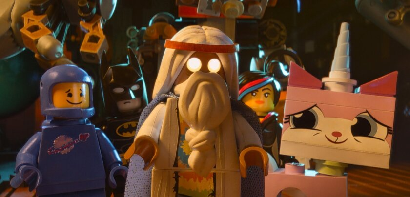 """This image released by Warner Bros. Pictures shows characters, from left, Benny, voiced by Charlie Day, Batman, voiced by Will Arnett, Vitruvius, voiced by Morgan Freeman, Wyldstyle, voiced by Elizabeth Banks and Unikitty, voiced by Alison Brie, in a scene from """"The Lego Movie."""" (AP Photo/Warner Br"""