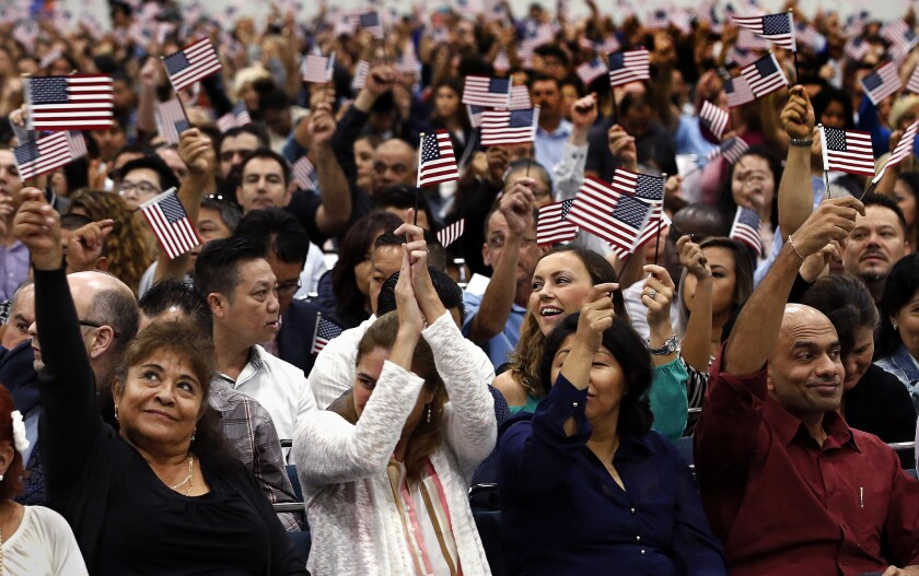 New citizens during a naturalization ceremony at the L.A. Convention Center.